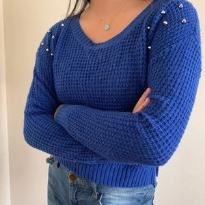 Cropped blue knitted sweater